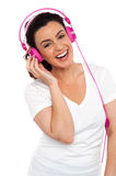 Young smiling woman listening to music Stock Photo