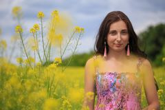 Woman with flying hair on yellow rape field Royalty Free Stock Photos