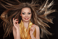 Young smiling woman with long hair Stock Photos