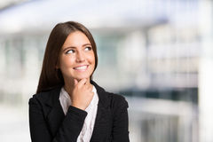 Young smiling woman looking up stock photography