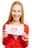 Young smiling woman with love letter Royalty Free Stock Photos