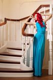 Young smiling woman with luxurious long beautiful red haired. Gi Stock Image