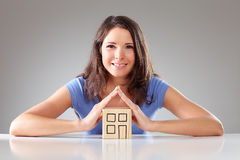 Young smiling woman make a roof with hands, symbolical Stock Photography