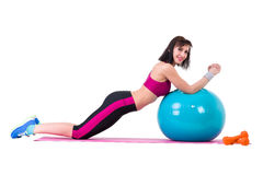 Young smiling woman makes exercise with fitball Stock Image