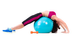 Young smiling woman makes exercise with fitball Stock Photos