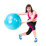 Young smiling woman makes exercise with fitball Royalty Free Stock Photography