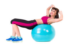 Young smiling woman makes exercise with fitball Stock Photo
