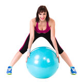 Young smiling woman makes exercise with fitball Stock Photography