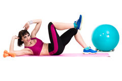Young smiling woman makes exercise with fitball Royalty Free Stock Photo