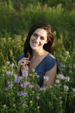 Young smiling woman in meadow Royalty Free Stock Photography