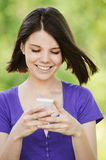 Young smiling woman with mobile Stock Photo