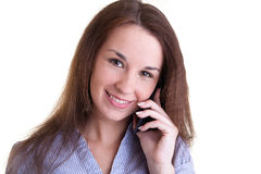 Young smiling woman with mobile phone Royalty Free Stock Photos