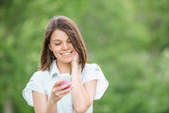 Young smiling woman with mobile phone Stock Photo