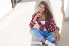Young smiling woman outdoors portrait Stock Image