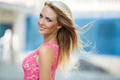 Young smiling woman outdoors portrait. stock photo