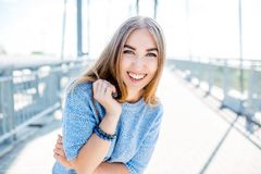 Young smiling woman outdoors portrait. Soft sunny colors.Close portrait. Bridge. Young smiling woman outdoors portrait. Soft sunny colors.Close portrait stock photography