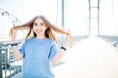 Young smiling woman outdoors portrait. Soft sunny colors.Close portrait. Bridge. Young smiling woman outdoors portrait. Soft sunny colors.Close portrait stock photo