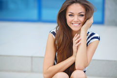 Young smiling woman outdoors portrait. Stock Photos