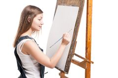 Young smiling woman painter with paintbrush Stock Image