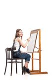 Young smiling woman painter with paintbrush Royalty Free Stock Photos