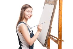 Young smiling woman painter with paintbrush Stock Photography
