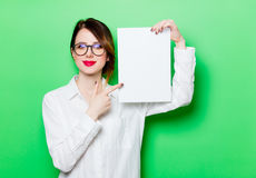 Young smiling woman with paper stock image