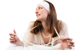 Young smiling woman with pearls Royalty Free Stock Image