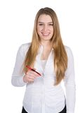 Young smiling woman with pen Stock Image