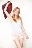 Young smiling woman with pillow. Bright white colors Stock Image