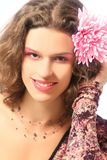 Young smiling woman with pink flower Stock Photo