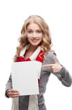 Young smiling woman pointing at sign Stock Photo