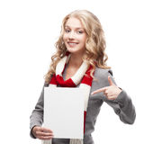 Young smiling woman pointing at sign Royalty Free Stock Photography