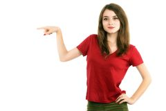 Young smiling woman points a hand with positive facial expressio Stock Photos