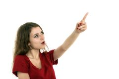 Young smiling woman points a hand with positive facial expressio Stock Photography