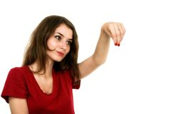 Young smiling woman points a hand with positive facial expressio Royalty Free Stock Photos