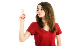 Young smiling woman points a hand with positive facial expressio Stock Photo