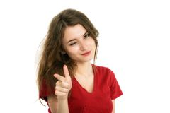 Young smiling woman points a hand with positive Stock Photo