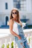 Young smiling woman portrait outdoors in the city. Stock Images