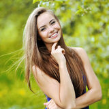 Young smiling woman posing in a green park Royalty Free Stock Photo
