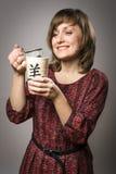 Woman prepares tea Stock Photos