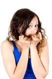 Young smiling woman pulling her hair Stock Images