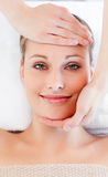 Young smiling woman receiving a head massage Stock Photo