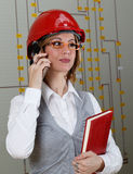 Young smiling woman with red helmet make call Royalty Free Stock Photos