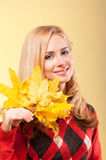 Young smiling woman in red sweater Stock Photo