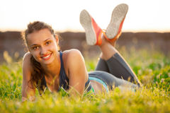 Young smiling woman resting after exercising Stock Photography
