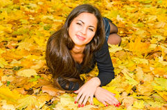Young smiling woman resting on the ground Royalty Free Stock Photo