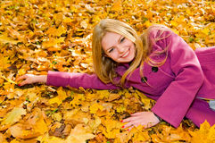 Young smiling woman resting on the ground Stock Photos