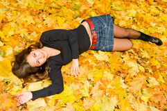 Young smiling woman resting on leaves Royalty Free Stock Photography