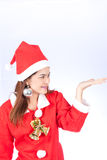 Young smiling woman in santa hat , holds christmas gift Stock Photo