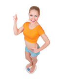 Young smiling woman on scales Stock Images